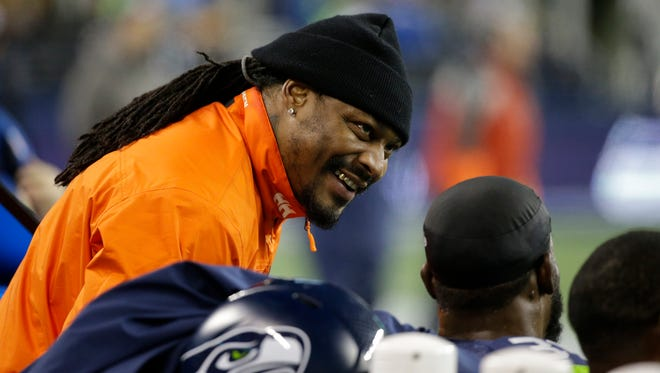 Former Seahawks running back Marshawn Lynch stands on the sidelines and chats with players during a December game at CenturyLink Field.