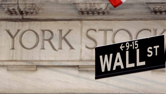 A Wall Street sign is seen at an entrance to the New York Stock Exchange.