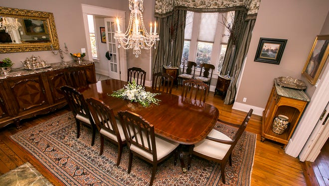 A 100-year-old handwoven Persian rug is the centerpiece of the dining room at the home of Laura and Junior Nelson.