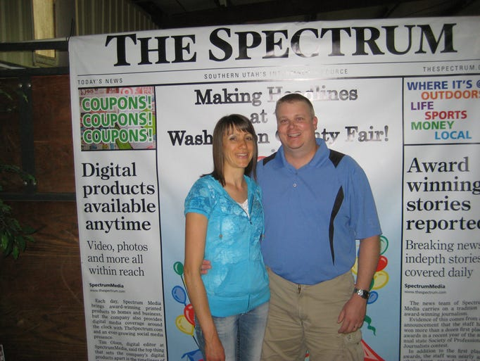 Washington County Fair-goers dropped by The Spectrum booth to have their photos taken in front of our big front page.