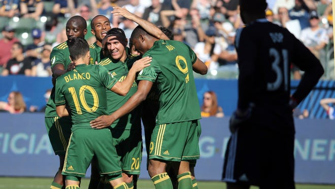 Portland Timbers celebrate a goal against LA Galaxy goalkeeper Clement Diop, right, in the first half of an MLS soccer match in Carson, Calif., Sunday, March 12, 2017.