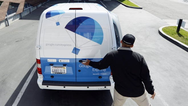 A Google Express van is seen at Google's Los Angeles headquarters in 2014.