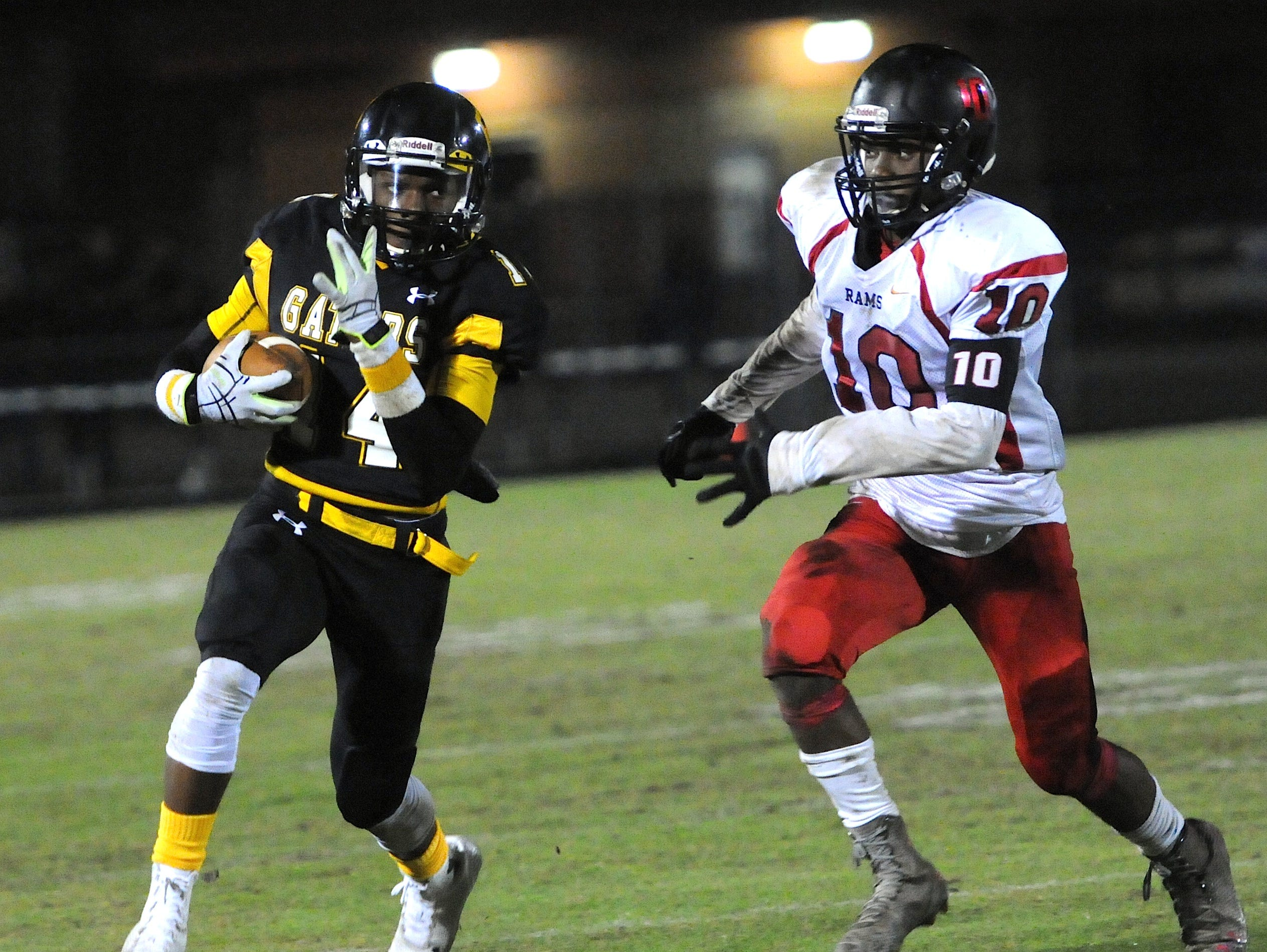 Goose Creek running back Rache McMillian (14) picks up a first down before being tackled by Hillcrest's Quendarius Jefferson.
