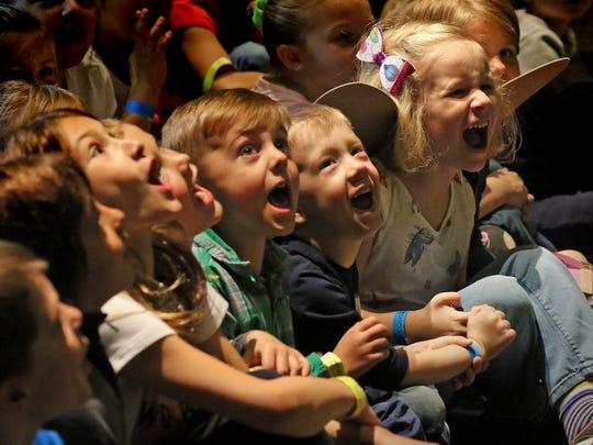 Children react to Tony Gustin during his Tony's Creepy