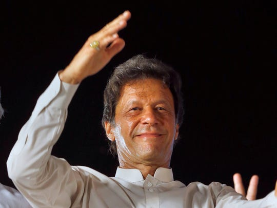 Lawmaker Ayesha Gulaliof the Pakistan Tehreek-e-Insaf party says her party leader Imran Khan sent her lewd text messages.  He waves to supporters during a rally in Islamabad, Pakistan in this July 30, 2017 file photo.