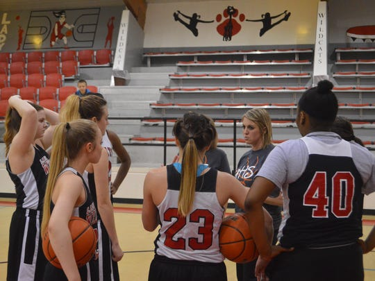 Glenmora first-year coach Kristi Sweat talks to her team during practice Tuesday.