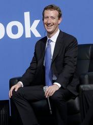 Facebook CEO Mark Zuckerberg smiles while speaking