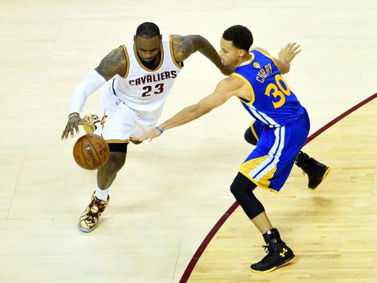 Stephen Curry defends LeBron James.