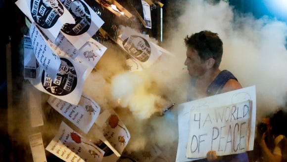 A demonstrator starts a fire during a protest in Philadelphia,