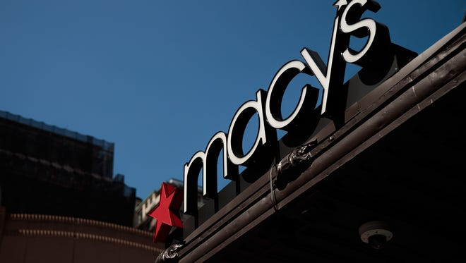 A Macy's sign hangs over its flagship store in Herald Square