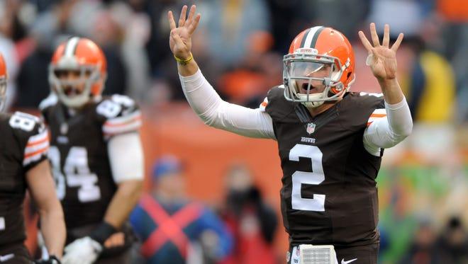 Dec 14, 2014; Cleveland, OH, USA; Cleveland Browns quarterback Johnny Manziel (2) calls a play against the Cincinnati Bengals during the second quarter at FirstEnergy Stadium.