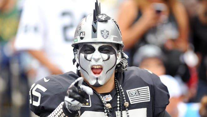 Oakland Raiders fan reacts from the stands during the second half of the game against the San Diego Chargers at Qualcomm Stadium.