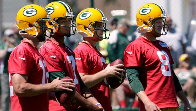 Green Bay Packers quarterbacks (from left) Aaron Rodgers, Brett Hundley,  Joe Callahan and Taysom Hill (8)  are shown during the team's organized team activities (OTA) June 6, 2017.