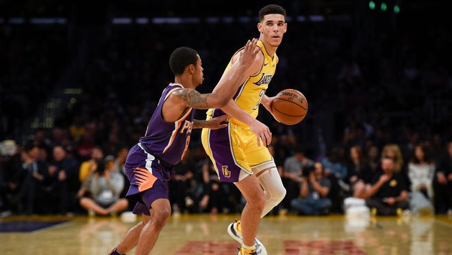 Nov 17, 2017; Los Angeles, CA, USA; Los Angeles Lakers guard Lonzo Ball (2) handles the ball defended by Phoenix Suns guard Tyler Ulis (8) during the second quarter at Staples Center. Mandatory Credit: Kelvin Kuo-USA TODAY Sports