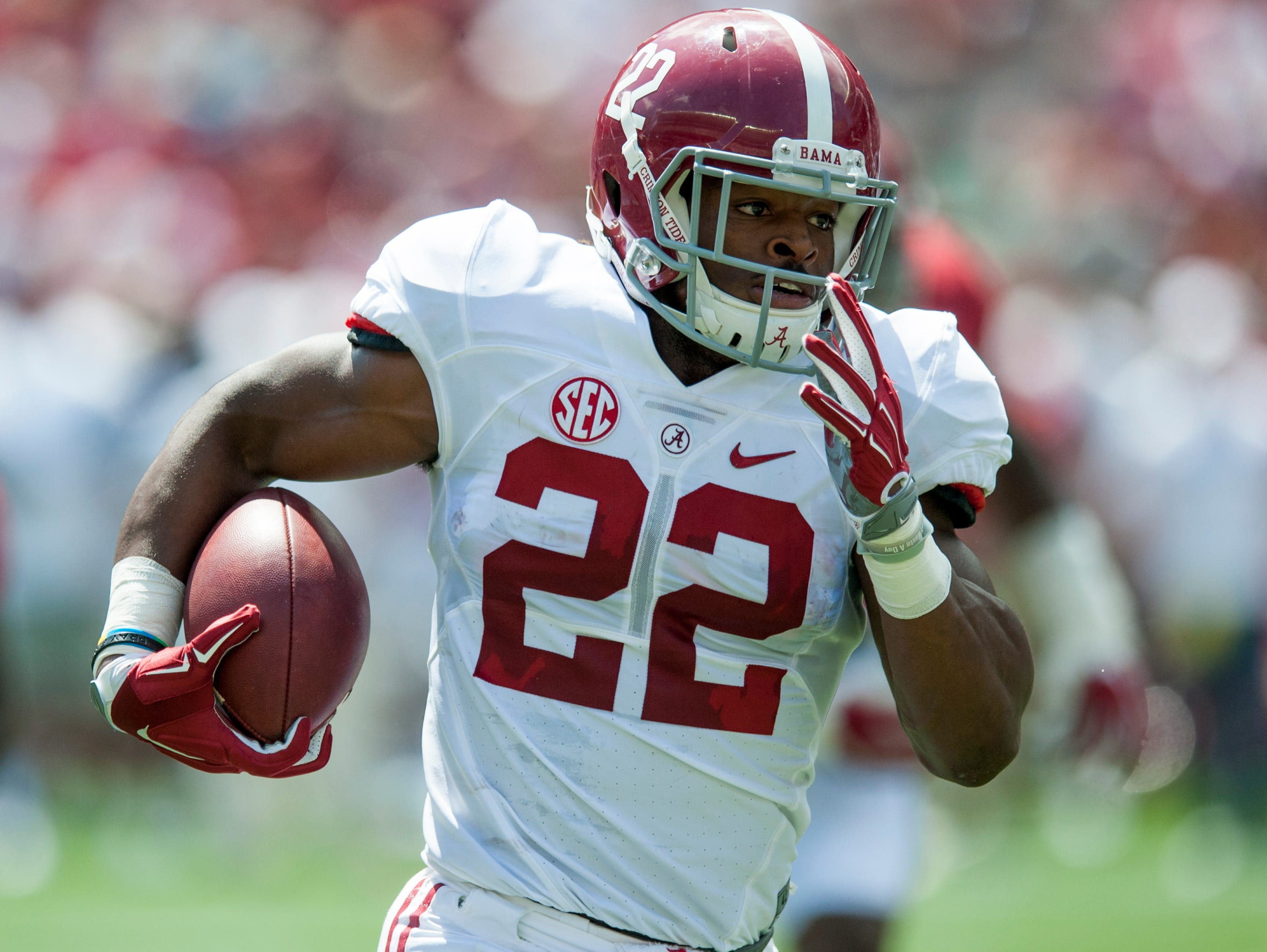 Alabama running back Najee Harris (22) carries during the A-Day scrimmage game at Bryant Denny Stadium in Tuscaloosa, Ala., on Saturday April 22, 2017.