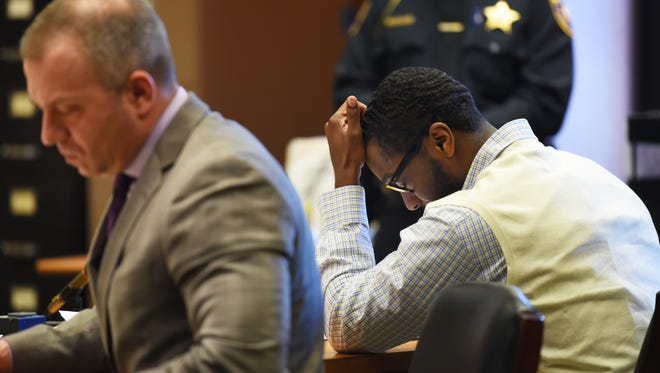 Basim Henry, one of four men charged in the death of Dustin Friedland, heads down as he sits next to his defense attorney Michael Rubas (L) during the fifth day of his trial  in the Essex County Superior Court in Newark on Thursday, March 23, 2017. Henry is one of four men charged in the death of Dustin Friedland during a Dec. 15, 2013 carjacking at The Mall at Short Hills.