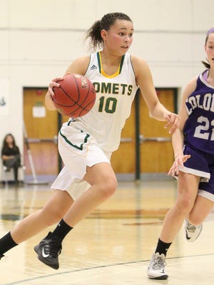 BFA's Hannah Earl drives to the hoop for two of her eight points during the Comets 52-26 semifinal win over Brattleboro at Patrick gym.