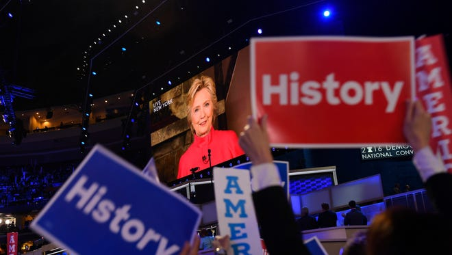 Hillary Clinton appears via video as she addresses the 2016 Democratic National Convention at Wells Fargo Arena.