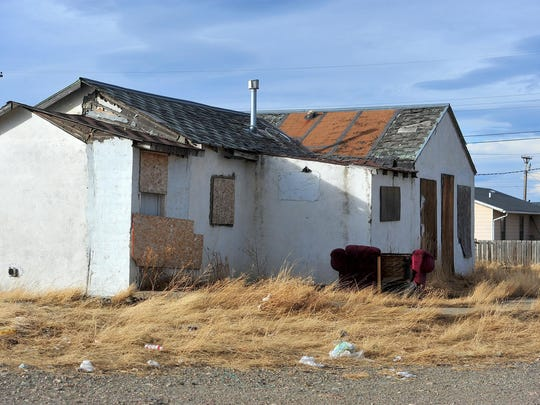 A boarded-up home in an area known as Moccasin Flats is shown on the Blackfeet Reservation in Browning.