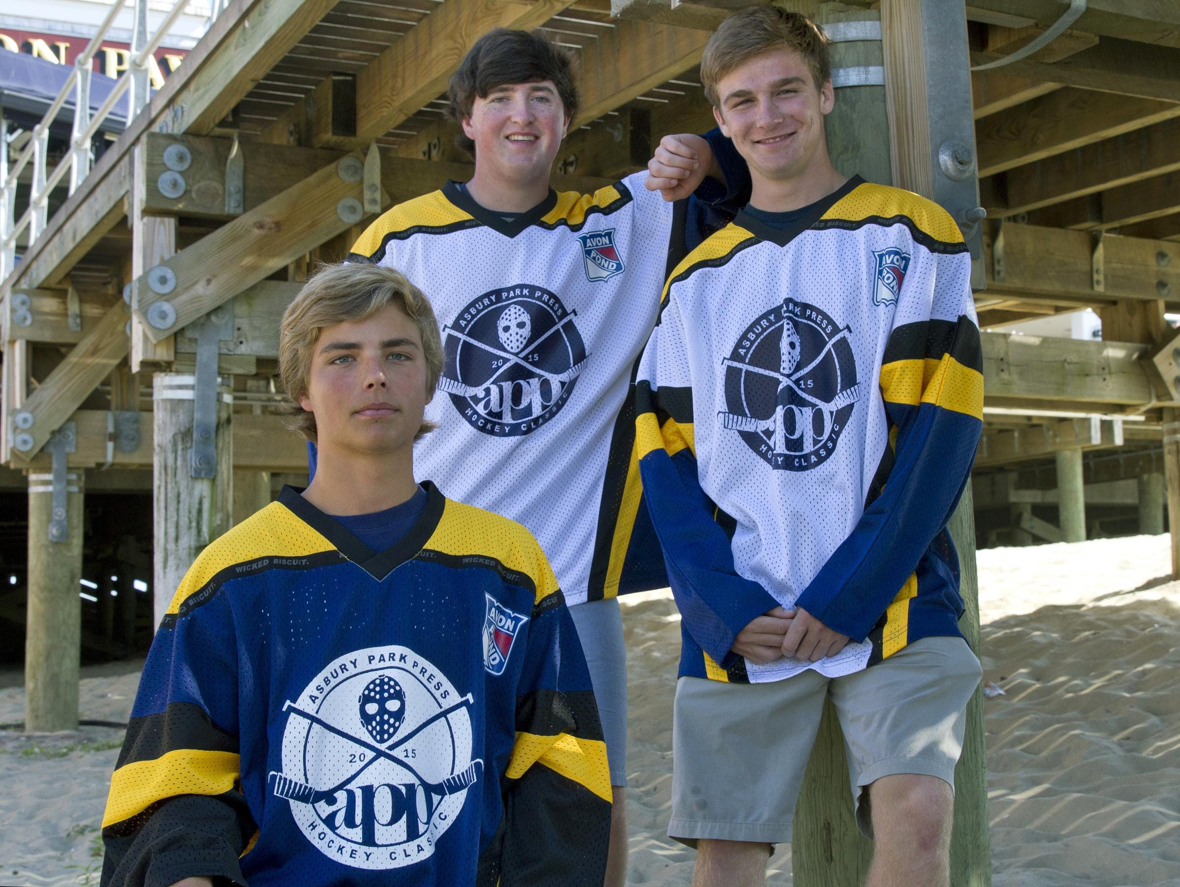 All Star Hockey players Matt Swan of Wall Township (front), Ryan O'Malley of St. Rose (back left), and Owen Herrington of Point Boro (back right) display jerseys for APP All-Star Game.