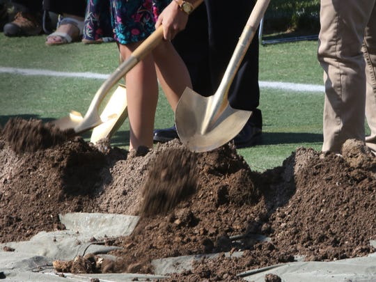 Dirt is tossed during a groundbreaking ceremony Aug. 30 for the expansion of Germantown High School. The project includes more classroom space, administrative offices, technology areas, fieldhouse, fitness center, pool and performing arts center. This is the fourth expansion to the original high school building.