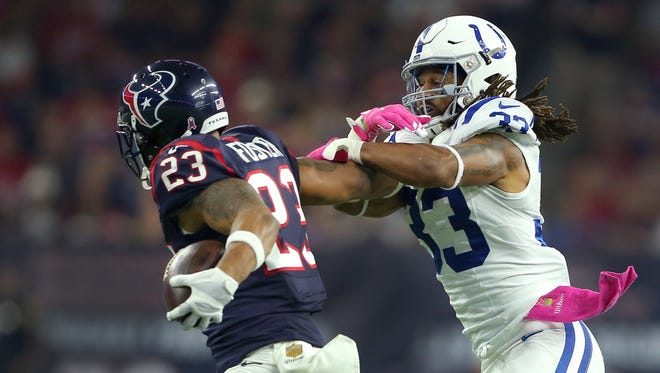 Texans running back Arian Foster (23) pushes away Colts free safety Dwight Lowery during their first matchup this season on Oct. 8 at NRG Stadium in Houston.