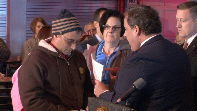 NJ Governor Chris Christie speaks with some of the protestors at Jimbo's Bar & Grill on the Seaside Heights boardwalk Friday, October 28, 2016, during what was planned as a commemoration on the fourth anniversary of Superstorm Sandy highlighting business and infrastructure rebuilding and recovery across impacted communities.