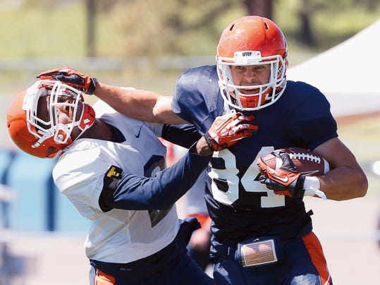 MARK LAMBIE — EL PASO TIMES UTEP wide receiver Cole Freytag stiff-arms defensive back Ishmael Harrison during action Wednesday at Camp Ruidoso.