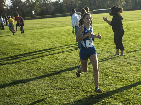 Kennard-Dale's Maddie Ferner races to the finish line during the YAIAA girls' cross country championship meet Tuesday at Gettysburg. Ferner pulled away in the final 800 meters to beat Eastern York's Maddie McLain by more than eight seconds.