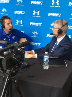 Missouri Valley Conference Commissioner Doug Elgin (right) talks with a representative from Indiana State at the 2017 Basketball Tipoff media day Tuesday in St. Louis, Missouri.