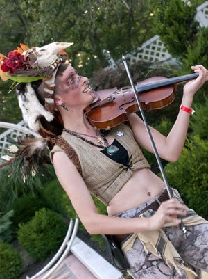 Costumed as a fairy violinist, Kirstyn Blandy was one of the hits as she wandered through the crowd of the 2016 Midsummer Masquerade.