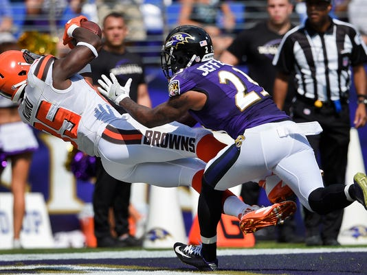 Cleveland Browns tight end David Njoku (85) pulls in a touchdown pass under pressure from Baltimore Ravens strong safety Tony Jefferson (23) during the first half of an NFL football game in Baltimore, Sunday, Sept. 17, 2017. (AP Photo/Nick Wass)