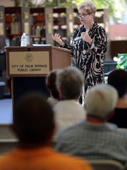 Michael's House alumni and event coordinator Renee Baribeau speaks during a dedication ceremony for Palm Springs Library's new addiction and recovery resource center on Sunday.