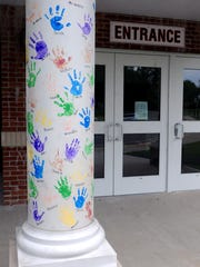 Hand prints made by children still adorn the pillars outside the former Milton Elementary School in Ulster County. The building is the new home for the Town of Marlborough Court and Police Department.