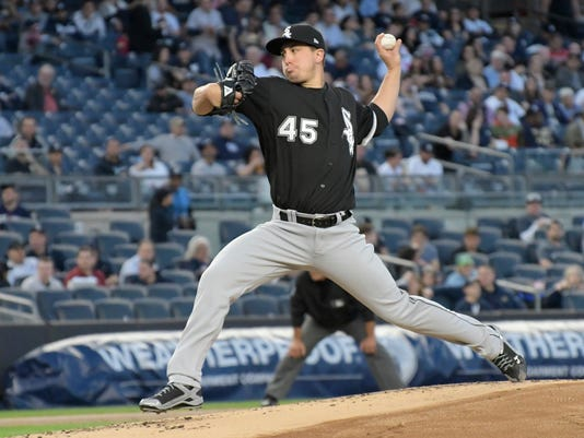 Chicago White Sox starting pitcher Derek Holland (45) delivers the ball to the New York Yankees during the first inning of a baseball game, Monday, April 17, 2017, at Yankee Stadium in New York. (AP Photo/Bill Kostroun)