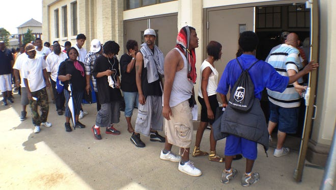 People waited in line in May 2013 for the Indiana State Fair's Job Fair. The jobs available last only during the fair, Aug. 2 to 18.
