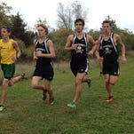 (From left) Howell's Lee Owens runs with Pinckney's Chase Schweyer, Nick Hartstang and Aaron Jarema during the teams' dual meet on Tuesday at Hudson Mills Metropark.