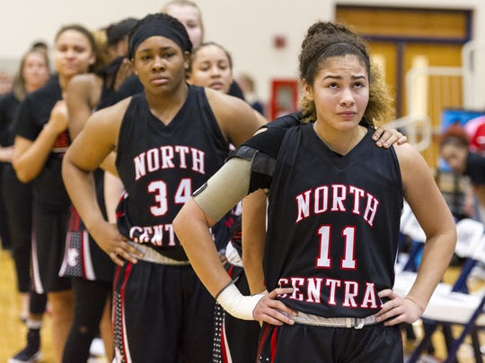 North Central High School junior Taylor Ramey (11) and her teammates react to their loss of the IHSAA 4A Girls' Basketball Tournament Regional championship game, Saturday, Feb. 11, 2017, at Decatur Central High School. Pike won in overtime, 61-59.