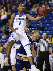 Delaware's Kevin Anderson gets two points in front of Cal Bakersfield's Brent Wrapp in the first half at the Bob Carpenter Center Wednesday.