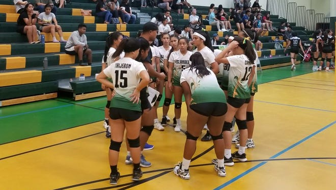 The John F. Kennedy Islanders take a time out down 20-18 in the third set against the Sharks. The Islanders battle back to win the set and the match.