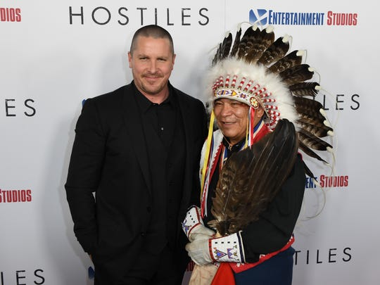 Christian Bale (left) and Chief Philip Whiteman attend