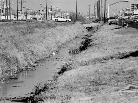 A view of the T&P Railroad right-of-way in Abilene looking east on South First and Shelton streets in the '70s or '80s. The railroad right-of-way was the first beautification project funded by the Dodge Jones Foundation in 1983. Abilenians had long complained of the right-of-way's condition and had held many meetings in years prior to clean up what many felt had turned into an eyesore.