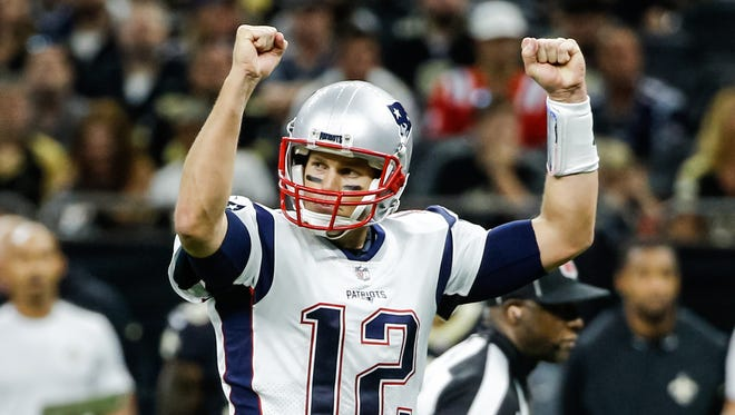 New England Patriots quarterback Tom Brady (12) celebrates after a play against the New Orleans Saints during the second half of a game at the Mercedes-Benz Superdome.