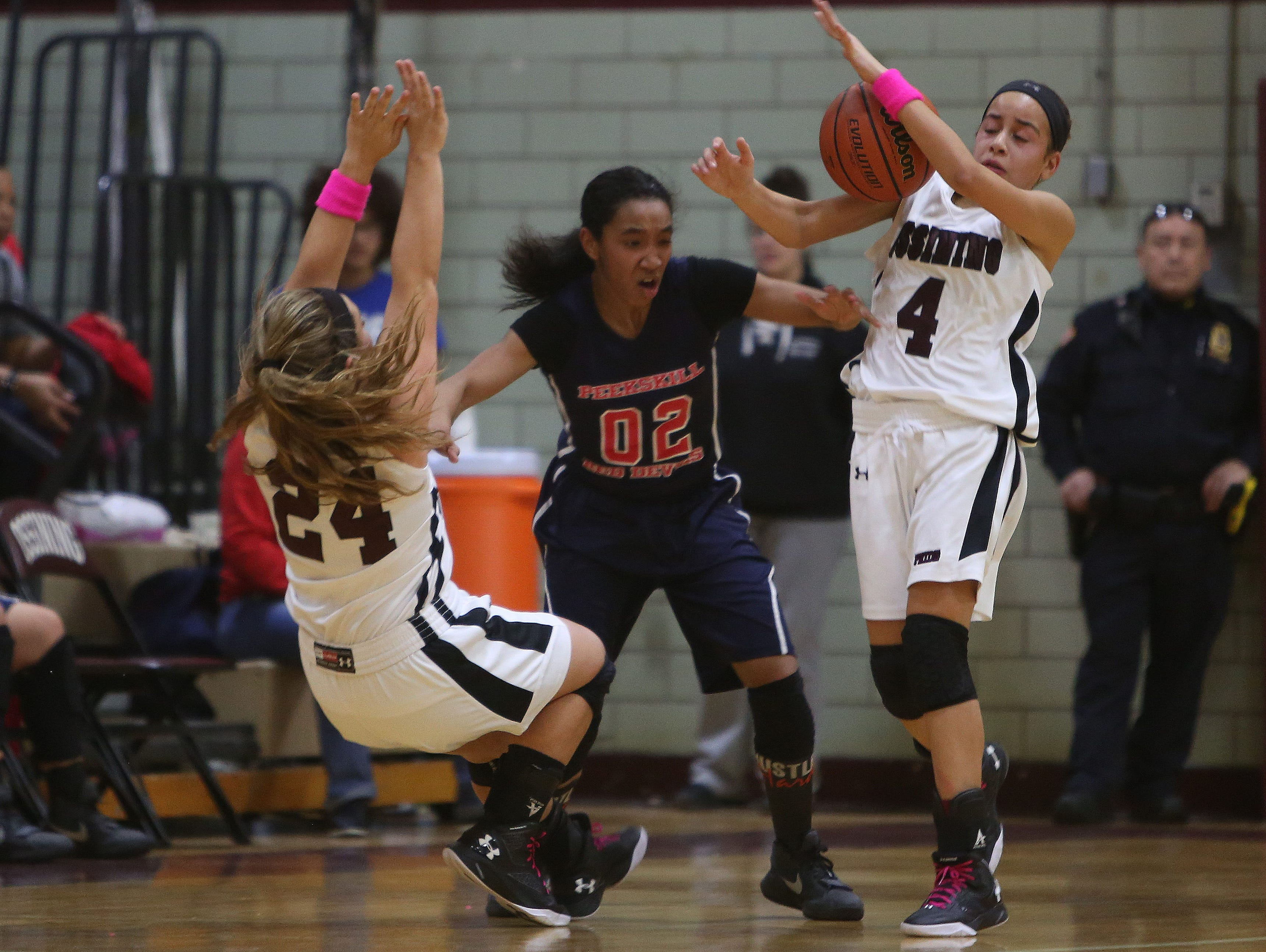 Peekskill's Lanay Rodney (02) has the ball stolen away by Ossining's Jaida Strippoli (4) after getting pressure from Samantha Cozzolino (24) during girls basketball game at Ossining High School Feb. 2, 2016.