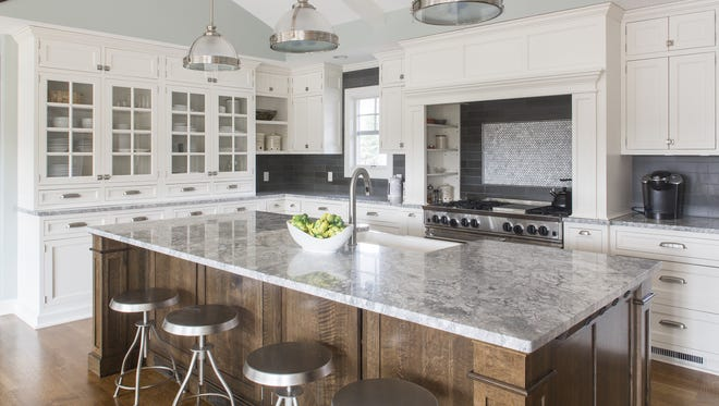 The Wachters of Pittsford wanted a marble countertop, so they brought home a piece to test. They purposely spilled spaghetti, wine, bacon grease and more on it. The marble didn't stand up, so they chose gray-marbled granite.