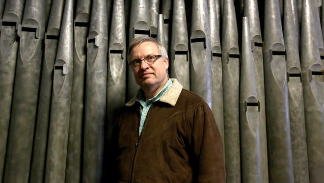 Covenant Organs owner Rick Helderop in front of organ pipes at his 6,000 square foot repair shop inside the Russell Industrial Center in Detroit on Tuesday, Dec. 20, 2016.