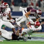 Sep 24, 2016; Dallas, TX, USA; Arkansas Razorbacks wide receiver Drew Morgan (80) is tackled by Texas A&M Aggies linebacker Richard Moore (7) and defensive back Priest Willis (24) in the second quarter at AT&T Stadium. Mandatory Credit: Tim Heitman-USA TODAY Sports ORG XMIT: USATSI-270122 ORIG FILE ID:  20160924_ggw_sh2_194.JPG