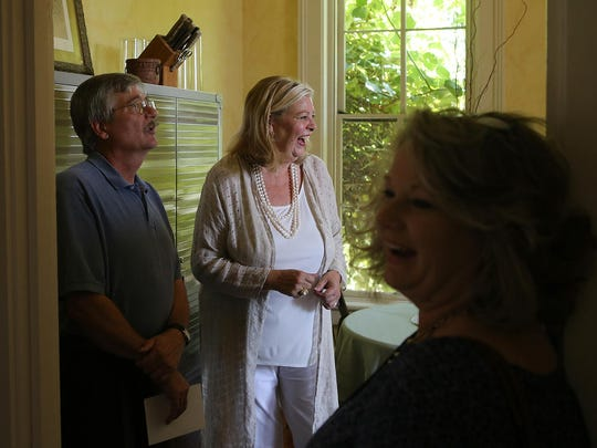 Tennessee Room Librarian Jack Wood, left, looks on as Kathi Leatherwood, center, and Kim Rainey laugh during a tour of The Cumberland House on Aug. 28 in Jackson. Kim Rainey is a descendant of Dinetia Walsh Hamilton, for whom The Cumberland House was built.