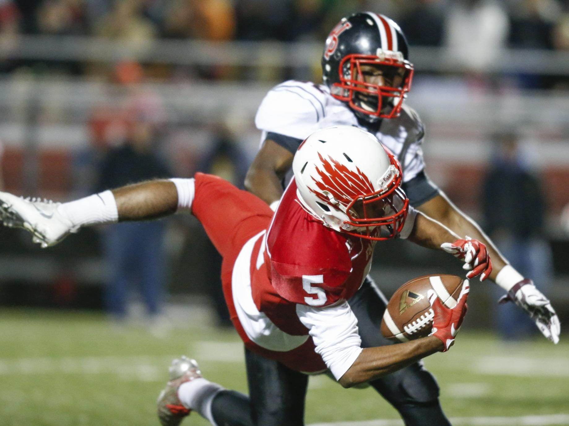 Smyrna receiver Emon Roberts twists for a catch on the Eagles' first drive in the first quarter of a DIAA Division I state tournament semifinal Friday at Smyrna High School. William Penn's Lance Edwards defends.