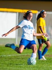 Buena's Ashley Armanini (1) clears the ball against